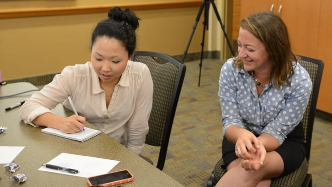 Saerom Yoo and Hannah Hoffman share ideas during an August 2014 training for the Statesman Journal at Broadway Commons in Salem.