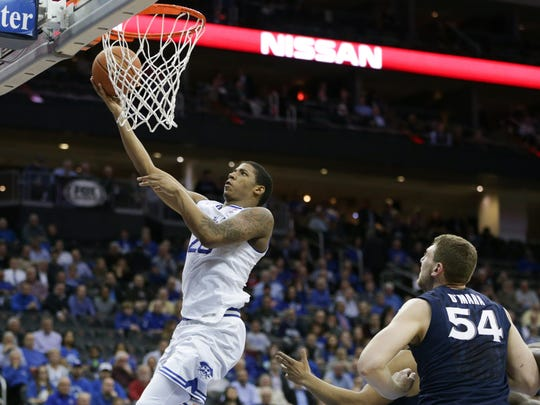 Seton Hall Pirates forward Desi Rodriguez (20) lays up the ball up in front of Xavier Musketeers forward Sean O'Mara (54)