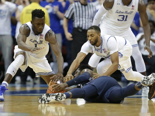 Feb 28, 2017; Newark, NJ, USA;  Seton Hall Pirates forward Michael Nzei (1) and guard Madison Jones (30) battle for a loose ball against Georgetown Hoyas guard L.J. Peak (0) during the second half at Prudential Center. Seton Hall won, 62-59.  Mandatory Credit: Vincent Carchietta-USA TODAY Sports