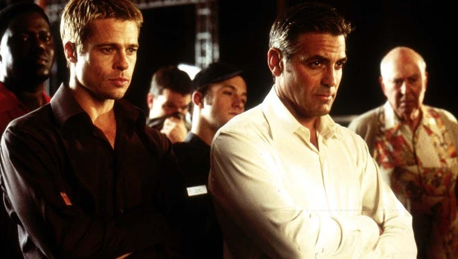 Brad Pitt  as Rusty Ryan and George Clooney as Danny Ocean star in Warner Bros. Pictures' and Village Roadshow Pictures' Ocean's Eleven.