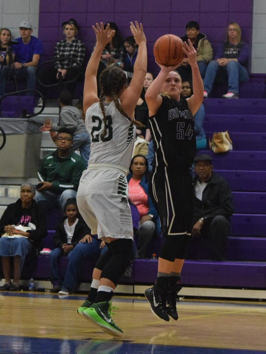 Jordyn Cross (54, right) goes for three against Bowling Green's Katelin Edwards (23, left) Saturday.