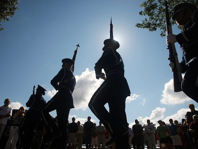 A color guard participates in the dedication ceremony co-naming Magnolia Drive after Jackson resident Private S. Wally Jamison, Sunday, August 24, 2014, in Jackson, NJ. Photo by Jason Towlen