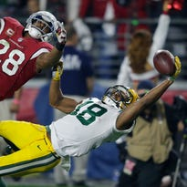 Green Bay Packers wide receiver Randall Cobb makes a diving catch against Arizona Cardinals cornerback Justin Bethel during an NFC divisional playoff game Jan. 16 in Glendale, Ariz. Penalties negated the catch, and Cobb was injured on the play.