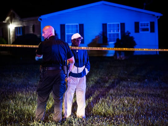 Police investigate a shooting at the intersection of