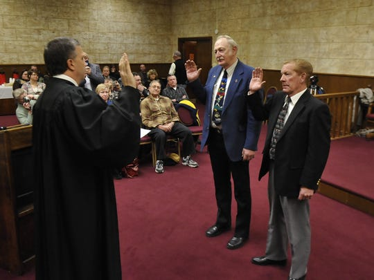 Burow, center, and Bob Jones, take the oath of office