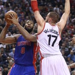 Pistons center Andre Drummond (0) goes up against Raptors center Jonas Valanciunas (17) at Air Canada Centre during the Pistons' 111-107 loss Saturday in Toronto.