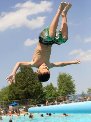 Laura Schmitt/Marshfield News-Herald Emmett Meissner, 9, of Chili, does a flip off the board at Hefko Pool in Marshfield on Wednesday, June 8, 2011.