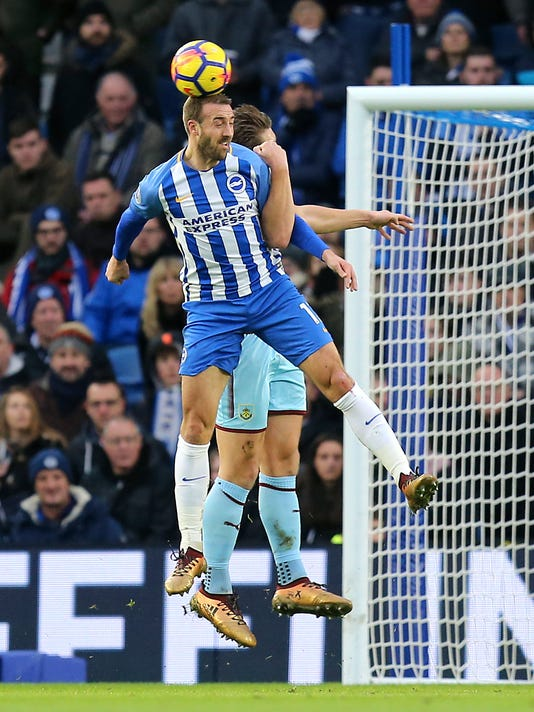 Brighton & Hove Albion's Glenn Murray heads the ball during the English Premier League soccer match between Brighton and Burnley, at the AMEX Stadium, in Brighton, England, Saturday, Dec. 16, 2017. (Gareth Fuller/PA via AP)