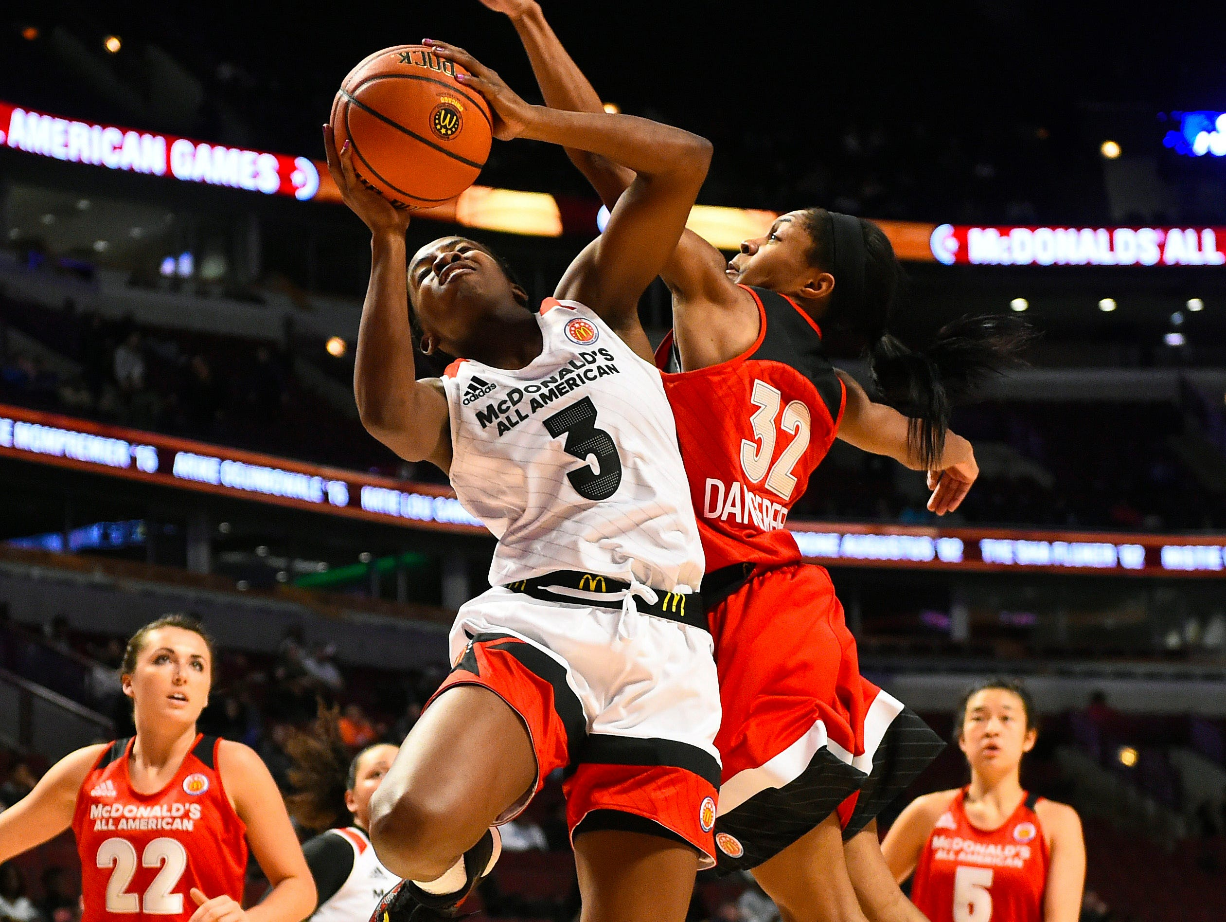 McDonalds High School All-American West player Jackie Young (3) shoots the ball against McDonalds High School All-American East player Crystal Dangerfield (32) during the second half at the United Center.