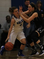 Looking to dribble past Plymouth's Jordyn Chouinard