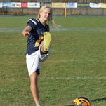 Maddie Pogarch jokingly strikes the Heisman pose while holding her helmet. She was on the field a handful of times, but left a lasting impression with her teammates and coaches on the Hartland football team.