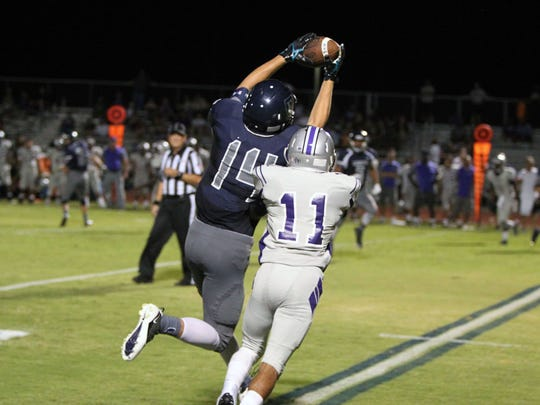 """""""I don't really think about what could happen,"""" said Higley junior receiver Bryce Gilbert, seen catching a pass on Aug. 28."""