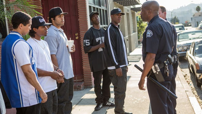 DJ Yella (Neil Brown Jr., left), Eazy-E (Jason Mitchell), Ice Cube (O'Shea Jackson Jr.), MC  Ren (Aldis Hodge) and Dr. Dre (Corey Hawkins) are harassed by officers in a scene from 'Straight Outta Compton.'