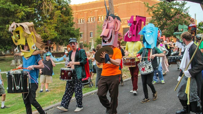 A drum line will lead the Doo Dah parade wearing giant puppet heads.