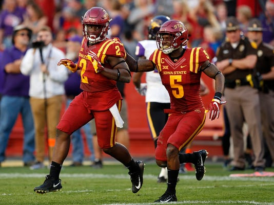 FILE - In this Sept. 2, 2017, file photo, Iowa State linebacker Willie Harvey (2) celebrates with teammate Kamari Cotton-Moya (5) after returning an interception 12 yards for a touchdown during the first half of an NCAA college football game against Northern Iowa in Ames, Iowa. Iowa State (2-1) has scored at least 40 points in each of its first three games for the first time since 1976; the Cyclones have never had four in a row. (AP Photo/Charlie Neibergall, File)