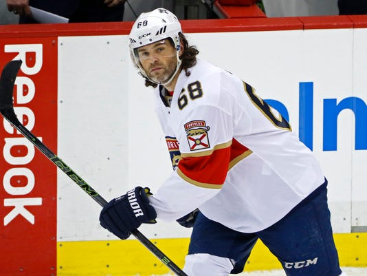 FILE - In this March 19, 2017, file photo, Florida Panthers' Jaromir Jagr skates in the team's NHL hockey game against the Pittsburgh Penguins in Pittsburgh. Making official what was suspected for some time, the Panthers revealed Saturday, July 1, 2017, that they're going in a different direction without the future sure-fire Hall of Fame forward. So on a day dominated by free-agent signings–like adding forwards Evgeny Dadonov, Radim Vrbata and Micheal Haley–the biggest news out of Florida was that Jagr is no longer in the Panthers' plans. (AP Photo/Gene J. Puskar, File)