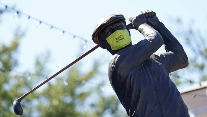 A mask was placed on a statue of Ben Hogan near the clubhouse during a practice round for the Charles Schwab Challenge golf tournament at the Colonial Country Club on Wednesday in Fort Worth, Texas.