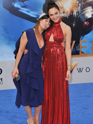 """Director Patty Jenkins, left, and actress Gal Gadot arrive at the premiere of """"Wonder Woman"""" in Los Angeles last May. Both will be return for the sequel, set for 2019."""