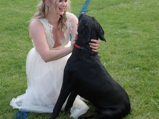 Carlyn Kimmey takes some time for her dog Bowser at