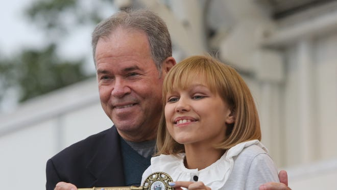 Ed Day, the Rockland County Executive gives Grace VanderWaal, the winner of America's Got Talent, the first ever key the county, as she was feted with a parade and a ceremony in the village of Suffern, Oct. 1, 2016.