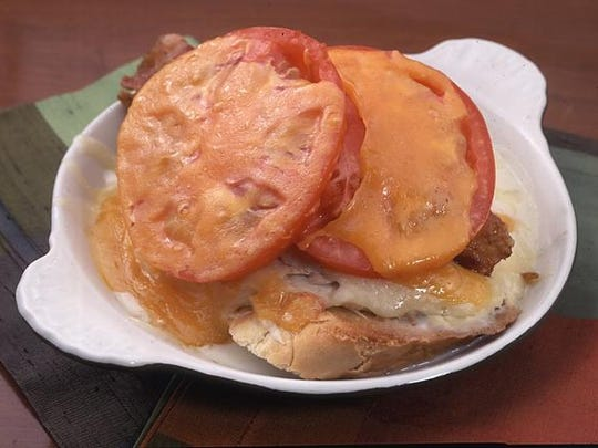 Lynn's Paradise Cafe's Hot Brown uses sourdough or French bread and Monterey Jack cheese.