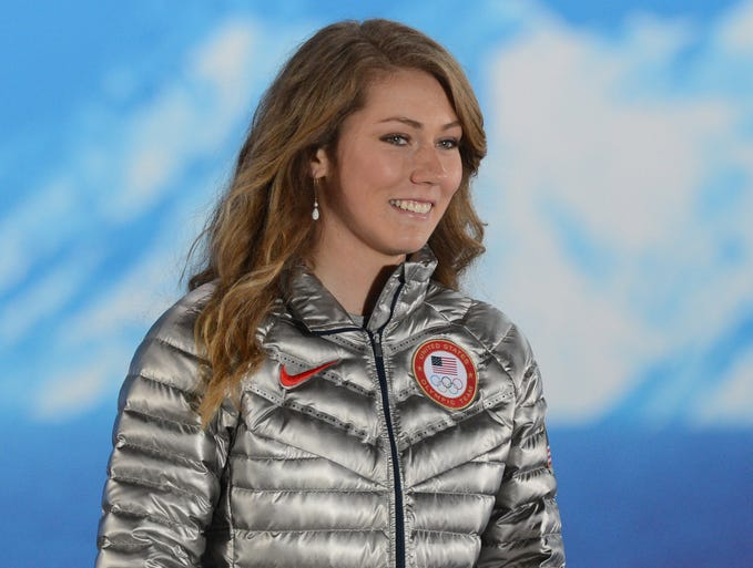 Shiffrin walks on stage to receive her gold medal in Sochi.
