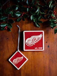 A Detroit Red Wings ornament and tile from Pewabic.