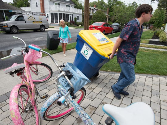 """Karen Kolobielski and her son Kyle are the founders of KK Kan Kare, a unique business in Rehoboth Beach that offers """"valet trash service."""""""