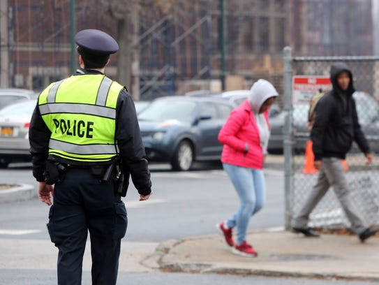 A police officer directs traffic at New Rochelle High