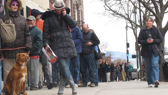 Neil Young fans bide their time in the line for Neil Young tickets in 2015 outside the Flynn Center in Burlington.