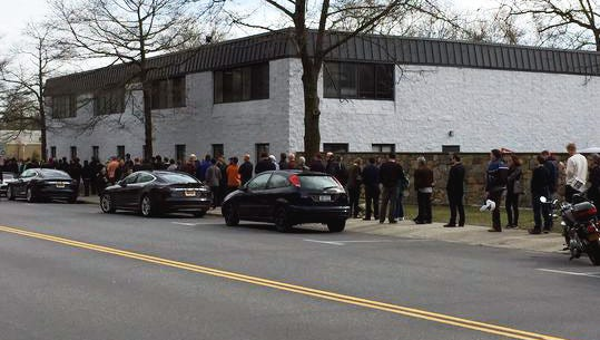 People wait in line outside the Tesla showroom at 115 Kisco Road in Mount Kisco to pre-order a Tesla Model 3 on Thursday, March 31, 2016.