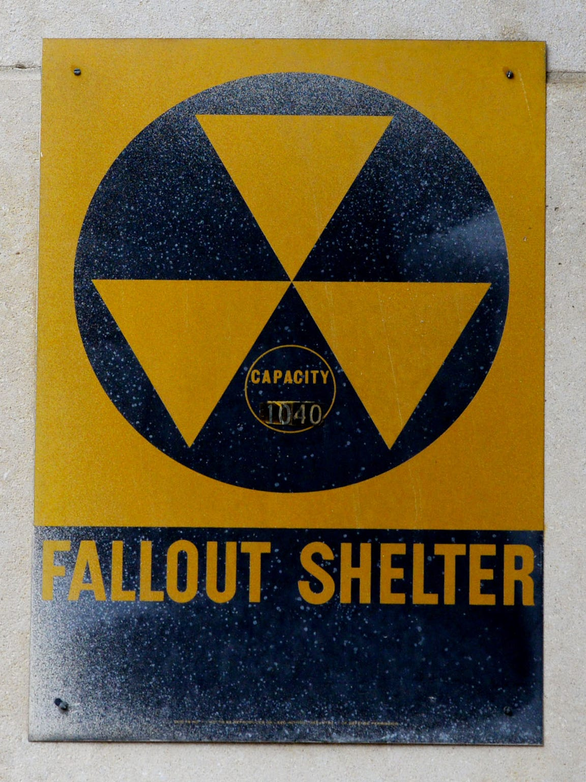 Robert W. Blakeley designed the yellow and black Fall Out Shelter sign that was used in the United States. This one still hangs on Bossier Elementary School.