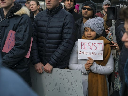 Protesters at John F. Kennedy International Airport in New York on Saturday denounce President Donald Trump's order suspending immigration from seven countries. Many high-profile acts of deadly extremist violence have been carried out either by U.S. citizens or by individuals whose families weren't from the nations singled out.