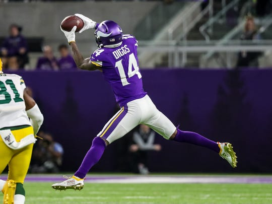 Dec 23, 2019; Minneapolis, Minnesota, USA; Minnesota Vikings wide receiver Stefon Diggs (14) catches a pass during the third quarter against the Green Bay Packers at U.S. Bank Stadium. Mandatory Credit: Brace Hemmelgarn-USA TODAY Sports