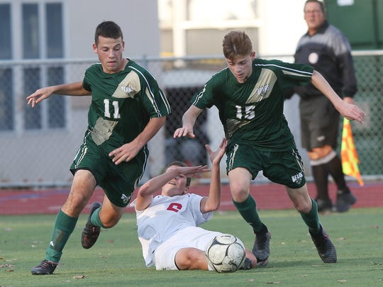 Vestal senior Carter Beaulieu (15) was a third-team all-state player for the Golden Bears in 2016. He and Parker McKnight plan to play for Binghamton University next season.