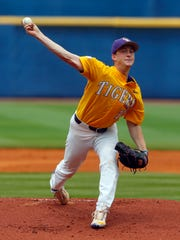 LSU pitcher Eric Walker (10) throws a pitch against Arkansas during the first inning of the championship game in the Southeastern Conference NCAA college baseball tournament, Sunday, May 28, 2017, in Hoover, Ala. (AP Photo/Butch Dill)