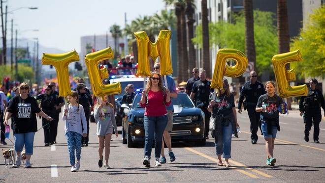Marchers from the city of Tempe participate during the Phoenix Pride Festival Parade on April 2, 2017.