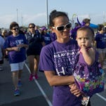 Cancer Survivor Brandy Villella and her daughter Brynn join other survivors during a past Relay for Life event in Gulf Breeze. The organization is hosting another Relay in May at the Maritime Park.