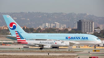 The difference in size between the Airbus A319 and A380 is readily apparent as the two jets taxi to gates after landing at  Los Angeles International Airport on Sept. 24, 2016.
