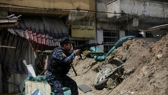 An Iraqi Federal Police soldier fires towards an Islamic State position on the western side of Mosul, Iraq, on April 29, 2017.