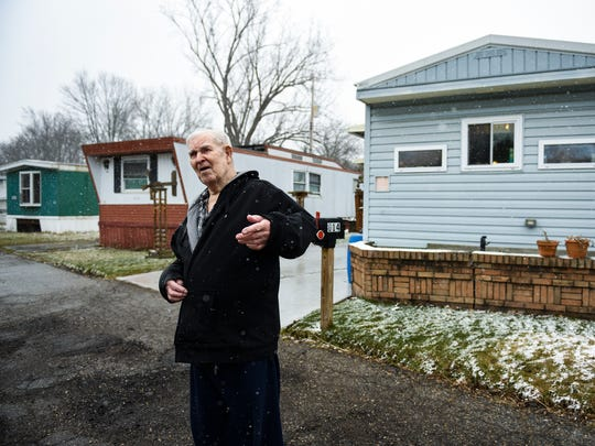 Don Ryckman, 86, of Lansing talks about the improvements he has made both inside and outside the home he shares with his ex-wife Carole, 82. They live in Riverview Estates Mobile Community, a trailer park adjacent to the Grand River off of Moores River Drive in S. Lansing.