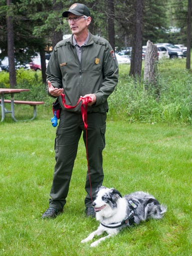 Mark Biel stands with Gracie, a Bark Ranger trained