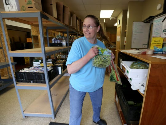 Volunteer Cathy Morris works in the food pantry at Catholic Charities St. Mary Family Center during the United Way of Central Iowa's Day of Action in 2014..