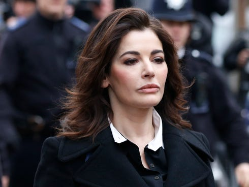 Celebrity chef Nigella Lawson arrives at Isleworth Crown Court in London on Dec. 4, 2013.
