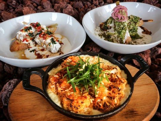Dishes from Artesano Vino Tapas Y Mas.  Pincho de Cordero,