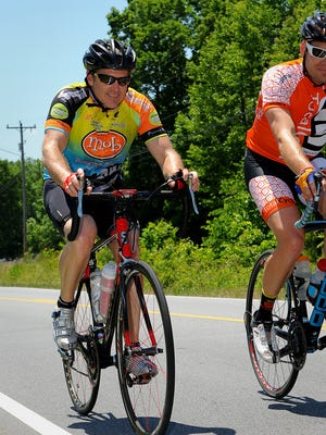 NASCAR driver Bobby Labonte, seen here riding in  his charity ride last year, will be in Asheville Wednesday.