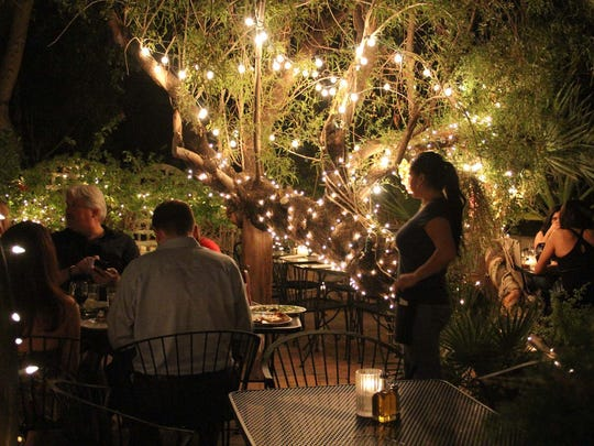 Fairy lights illuminate the porch at Cibo in downtown