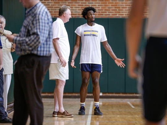 Former Indiana Pacers President of Basketball Larry Bird talks with Purdue basketball standout Caleb Swanigan after a pre-draft workout for the Pacers at Bankers Life Fieldhouse on Monday, May 15, 2017.