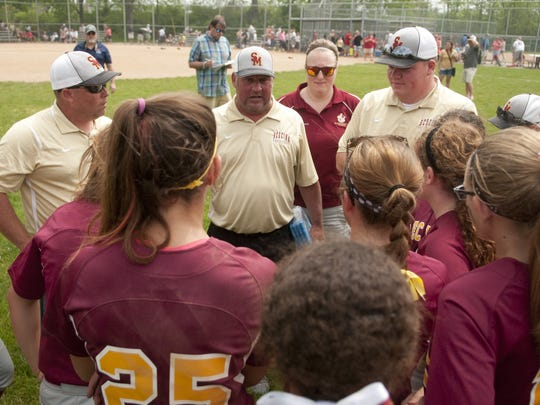 Scecina head coach Cory Gray addressed his team in 2015, a little more than a year before his stroke last July.  The team had just won the high school city softball title game.