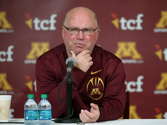 Then-University of Minnesota NCAA college football coach Jerry Kill becomes emotional as he speaks during a press conference in Minneapolis on Oct. 28, 2015.  Jerry Kill has been seizure-free for almost a year and a half.